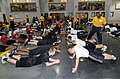 US Navy 090314-N-8848T-596 Navy Junior Reserve Officers Training Corps (NJROTC) Cadets perform pushups in the Pacific Fleet Drill Hall at Recruit Training Command.jpg