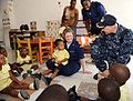 US Navy 090416-F-7522G-002 Chaplain Cmdr. David Oravecand and Aerographer's Mate Gina Hegg, both embarked aboard the Military Sealift Command hospital ship USNS Comfort (T-AH 20), entertain students at Emmanuel Christian School.jpg