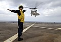 US Navy 090502-N-7478G-182 Boatswain's Mate 3rd Class Christine Bagley, assigned to the amphibious command ship USS Blue Ridge (LCC 19), launches a helicopter carrying Japan Maritime Self-Defense Force Rear Adm. Hitoshi Noguchi.jpg