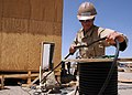 US Navy 090515-N-9410R-061 Construction Electrician Constructionman Benjamin Gerstenmaier, assigned to Naval Mobile Construction Battalion (NMCB) 5, unspools electrical cable.jpg