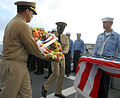 US Navy 090606-N-5251G-055 Executive Officer, Cmdr. Bruce Stanley and Command Master Chief (SW-AW) Mamudu Cole, carry the Battle of Midway wreath.jpg