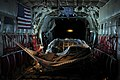 US Navy 091122-N-4154B-010 Explosive Ordnance Disposal Technician 2nd Class Edwin Sharpe rests in a hammock in the cabin of a U.S. Air Force C-130 airplane.jpg