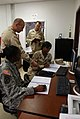 US Navy 100106-A-4297G-027 Service members assigned to the Joint Task Force Guantanamo supply office train on their electronic inventory system.jpg