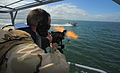 US Navy 100422-N-4965F-784 Boatswain's Mate 1st Class Jason Fuchs, a boat crewman gunner assigned to a boat detachment of Maritime Expeditionary Security Squadron (MSRON) 3, engages a simulated waterborne threat.jpg