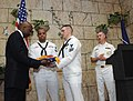 US Navy 100504-N-5208T-005 Sailors assigned to the ballistic-missile submarine USS Alabama (SSBN 731) present an Alabama state flag that was flown over the submarine.jpg
