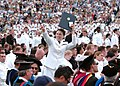 US Navy 100528-N-3857R-367 A midshipman celebrates after receiving her diploma during the U.S. Naval Academy 2010 graduation and commissioning ceremony.jpg