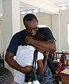 US Navy 100621-A-4015L-028 Petty Officer 2nd Class Pierre Poteau hugs his sister for the first time in eight years at the New Horizons Haiti 2010 Estere medical site.jpg