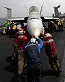 US Navy 100724-N-6362C-194 Flight deck crew members manually move an F-A-18C Hornet assigned to the Checkerboards of Marine Fighter Attack Squadron (VMFA) 312.jpg