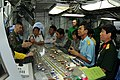 US Navy 100808-N-4830B-033 Capt. Daniel Grieco, left, executive officer of the aircraft carrier USS George Washington (CVN 73), explains flight deck operations to senior military and civilian officials from Vietnam.jpg