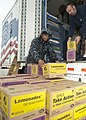 US Navy 110331-N-NY820-092 Culinary Specialist 1st Class Aaron Gilliam helps unload cases of Girl Scout cookies donated through the Troop to Troop.jpg
