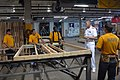 US Navy 110412-N-QE550-011 Rear Adm. Sadler speaks with Sailors from Navy Recruiting District Dallas during a community service event with Habitat.jpg
