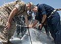 US Navy 110726-N-GZ228-044 Navy ROTC midshipmen aboard USS Nitze (DDG 94) patch a pipe during a damage control exercise.jpg