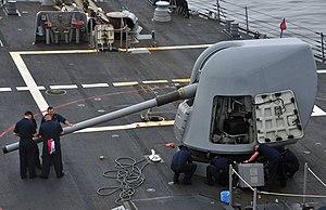 US Navy 120124-N-OP638-043 Sailors clean the MK-45 5-inch.54-caliber lightweight gun during an all-hands preservation call.jpg
