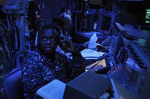US Navy 120214-N-IO627-007 Lt. j.g. Jhon Alseide, ballistic-missile defense officer aboard the guided-missile destroyer USS Stethem (DDG 63), respo.jpg