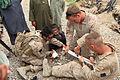 US Navy http-www.navy.mil-management-photodb-photos-100516-M-5207F-019 Hospital Corpsman Dan Royston and Lance Cpl. Kaleb Hyndman treat a child after a shura in Garmsir, Afghanistan.jpg