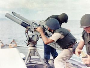 Point-class cutter - Gun crew on board USCGC Point Comfort (WPB-82317) firing 81mm mortar during bombardment of suspected Viet Cong staging area one mile behind An Thoi.(August 1965)