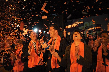Rutte with Henk Kamp (left) and Rita Verdonk (right) during the campaign in 2006 VVD campagne kick off 2006.jpg