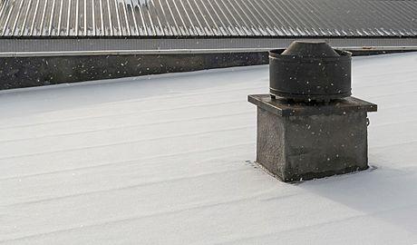 Ventilation cap on roof in snow.jpg