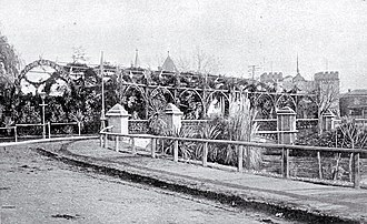 Hamish Hay Bridge - Victoria Bridge decorated with the floral arches in honour of the Duke and Duchess of Cornwall and York in June 1901