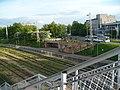 View from the pedestrian bridge to Vagonu parks train station and Maskavas forštate.jpg