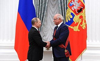 Nikita Mikhalkov - President Vladimir Putin awards the 1st Degree Order of Merit for the Fatherland to Mikhalkov, 10 December 2015.
