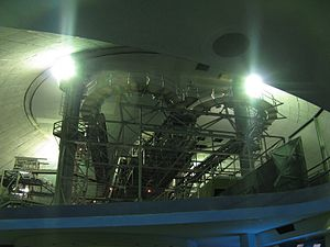 Space Mountain (Magic Kingdom) - The 180 degree turn-arounds at the top of the lift hills, as seen from the queue with the work lights on. This view is no longer possible because of ceilings installed over the loading stations. These turnarounds are still visible when riding the Tomorrowland Transit Authority PeopleMover through Space Mountain when the lights are on.