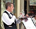 Waiter in a terrace cafe in Paris France.jpg