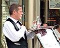 Waiter in a terrace cafe in Paris France.jpg