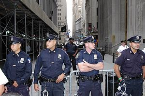 English: NYPD officers stand at the west end o...