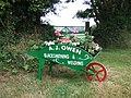 Wheelbarrow flower planter in Trecŵn, Pembrokeshire, Wales.jpg