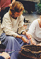 Woman and girl braids yarn Holland.jpg