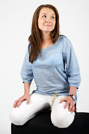 Woman in blue shirt and white pants on August 2009 02.jpg