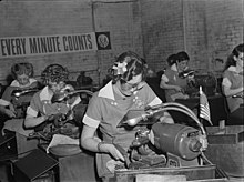 Women in industry. Tool production. A job which was formerly done by hand (and by men) is done in this large Midwest drill and tool plant by women at machines. These young workers are putting precision-ground points on drills which will be used in production of America's ships, tanks and guns. It takes at least four months to train these young women in the operation of these machines, but at the end of that period their work is speedy and efficient, and this company has found that both production and the quality of the drill points have improved. Republic Drill and Tool Company, Chicago, Illinois.