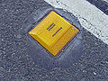 Yellow raised pavement marker.jpg