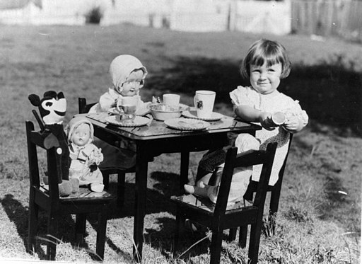 Young girl entertaining Mickey Mouse and other friends at a make-believe tea party, 1930s (5141973960)