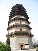 A wide, octagonal pagoda. It has four tall, functional floors made of brick, and an additional five, short, purely decorative floors made of wood. Each floor is separated by an eave, and the top five-floor's eaves look as if they were simply stacked right on top of one another.