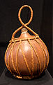 'Ue (gourd) from Cook Islands made from a gourd and sennit (coconut-husk fibre).jpg