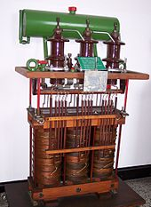 oil-cooled three-phase distribution transformer, similar to one in above  photo, with housing off, showing construction
