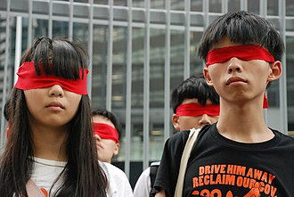 Joshua Wong - Joshua Wong and Agnes Chow on 23 September 2014. They wear red blindfolds to symbolize students figuratively blinded by China's political power.