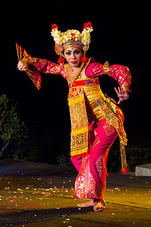 Balinese dance - A woman dancing Legong Bapang Saba. Balinese dances incorporate eye and facial expressions.