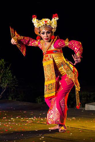 Balinese dance - A woman dancing Legong Bapang Saba. Balinese dances incorporate eye and facial expressions.