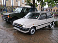 1989 Austin Metro 1.0 City and Range Rover (14688902210).jpg