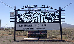 2014-05-31 13 56 25 Sign at the north entrance to Crescent Valley, Nevada along Nevada State Route 306-cropped.JPG