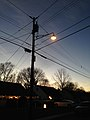 2014-12-26 17 01 34 Incandescent street light just after turning on for the night on Fireside Avenue at Meridan Avenue in Ewing, New Jersey.JPG