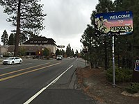 """2015-10-28 13 48 32 """"Welcome to Nevada"""" sign along southeastbound State Route 28, crossing from Kings Beach, California to Crystal Bay, Nevada.jpg"""