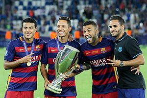 Dani Alves - Dani Alves (second from the right) posing with the 2015 UEFA Super Cup, alongside compatriots Rafinha, Adriano and Douglas.