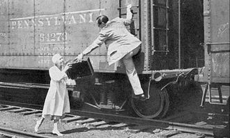 Jane Ace - Listener postcard from Easy Aces sponsor, Lavoris, about new episodes of the program beginning September 26, 1932. The couple appears to be returning from vacation by freight train.