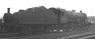 LMS Hughes Crab - 42884 at Carlisle in 1960. Note the Fowler tender which is narrower than the locomotive.