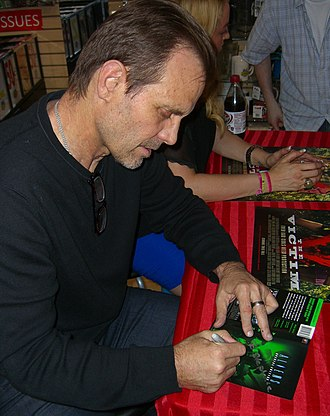 Aliens (film) - Michael Biehn signing a copy of the film's DVD cover at an August 2012 Midtown Comics appearance