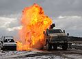 A-german-army-dingo-vehicle-drives-through-a-simulated-roadside-bomb-blast-during-joint-training.jpg